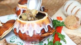 Spoon stir soup in a pot stock video