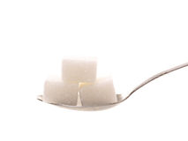 Spoon with sugar cube Royalty Free Stock Image