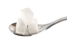 Spoon with sugar cubes Stock Photography