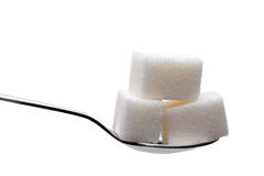 Spoon with sugar cubes isolated Stock Photography