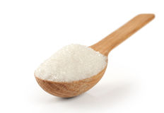 Spoon with sugar on a white background. Stock Image