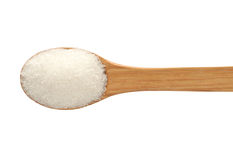 Spoon with sugar on a white background. Stock Photography