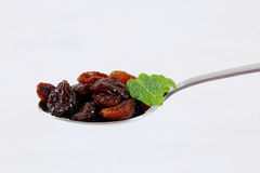 Spoon of sweet raisins Royalty Free Stock Image