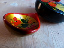 Spoon and tableware. Closeup. Khokhloma - an ancient Russian folk craft XVII century. Traditional elements Khokhloma - red juic Royalty Free Stock Photos