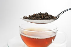 A spoon with tealeafs Stock Image