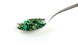 Spoon with thumbtacks Royalty Free Stock Photo