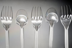 Spoon two, three forks Royalty Free Stock Image
