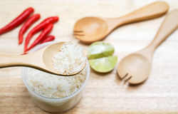 Spoon up the jasmine rice. With food ingredients background Stock Image