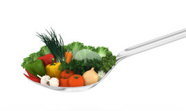 Spoon of vitamins. Full spoon of fresh vegetables Royalty Free Stock Photo