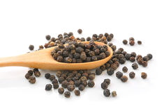 Spoon with Whole Black Pepper Granules Stock Image