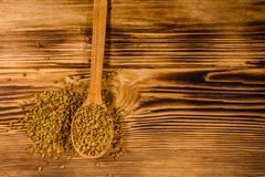 Free Spoon With Fenugreek Seeds On Wooden Table. Top View Stock Photography - 160888172