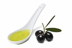 Spoon With Olive Oil And Olives. Royalty Free Stock Photography