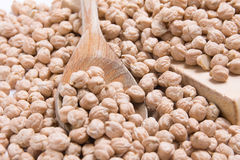 Spoon wood in chickpeas Royalty Free Stock Photo