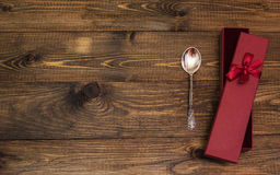 Spoon on wood table Royalty Free Stock Images