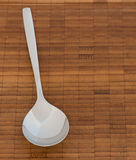 Spoon on a wooden surface Stock Image
