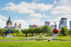 The Spoonbridge and Cherry at the Minneapolis Sculpture Garden. MINNEAPOLIS - JUNE 14: The Spoonbridge and Cherry at the Minneapolis Sculpture Garden on June 14 royalty free stock photography