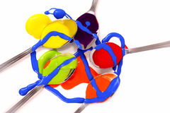 Spoonerism. Abstract of tea spoons with brightly coloured children's paints stock images
