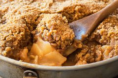 Spoonful of apple crisp or crumble baked dessert Stock Image