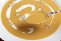 Spoonful of butternut squash soup Royalty Free Stock Images
