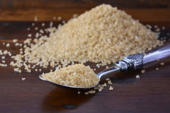 Spoonful of coffee sugar crystals. Royalty Free Stock Photo
