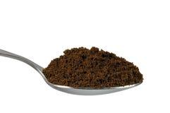 Spoonful del caffè a terra fine del caffè espresso dell'arabica Fotografia Stock