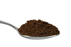 Spoonful do café à terra fino do café da goma-arábica Fotografia de Stock