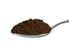 Spoonful fine ground medium roasted Arabica coffee Royalty Free Stock Photo