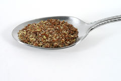 Spoonful of Flax. A spoonfull of healthy flax seeds and meal Stock Image