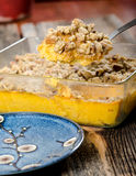 Spoonful of Pecan Cake Dessert. Above a Pyrex dish of Cake about to be Served Royalty Free Stock Image