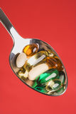 Spoonful of Pills. Isolated Royalty Free Stock Images