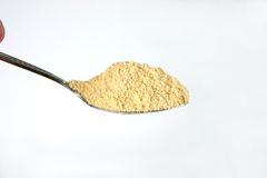 Spoonful of powder. Close-up isolated image of a spoon and powder Stock Photos