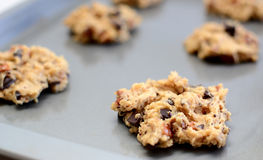 Spoonful of raw cookie dough ready for the oven Royalty Free Stock Photo