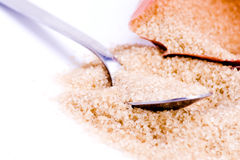 Spoonful of sugar. A mound of brown sugar with a spoon stock photo