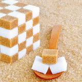 Spoonful of sugar cubes Royalty Free Stock Photos