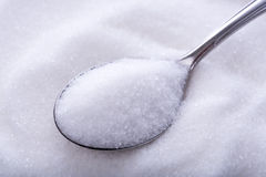 Spoonfuls of crystal white sugar Royalty Free Stock Images