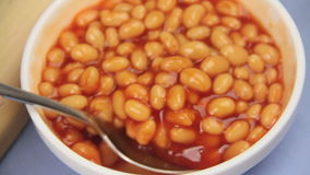 Spooning Baked Beans stock video footage