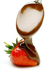 Spooning Chocolate Onto A Strawberry Stock Images