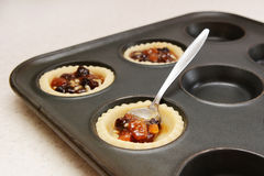 Spooning mincemeat into pastry cases Stock Image