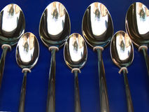Spoons. Several spoons in blue, reflecting the street stock photography