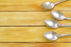 Spoons on a background of wooden planks Stock Images