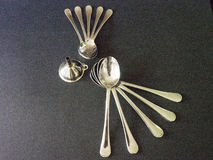 Spoons. On the black background Stock Images