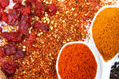 Spoons of chili flakes chillies and chili powder Royalty Free Stock Images