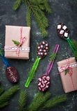Spoons with chocolate. Christmas present. For children. Top view Royalty Free Stock Images