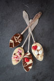 Spoons with chocolate Stock Photos