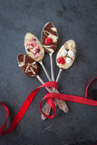 Spoons with chocolate. Vintage silver spoons with dark and white chocolate royalty free stock image