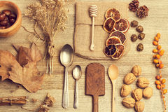 Spoons, cinnamon and a bowl of nuts Royalty Free Stock Image