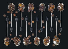 Spoons with coffee beans Royalty Free Stock Image