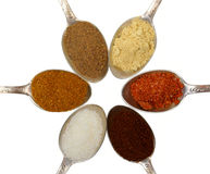 Spoons with colored seasoning Royalty Free Stock Images