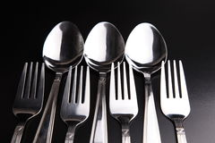 Spoons and forks Stock Images