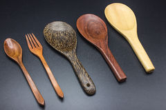 Spoons, forks, ladles made of wood. Stock Photo